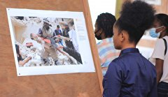 A visitor looks at photos during the opening ceremony of the Stenin Photo Contest exhibition in Kinshasa, Congo.